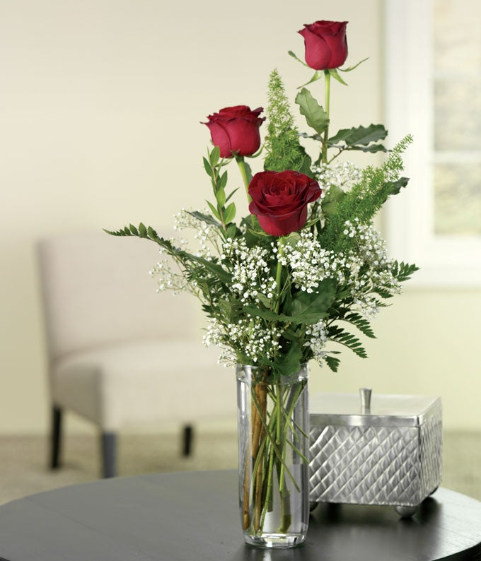 Red rose bud vase arrangement