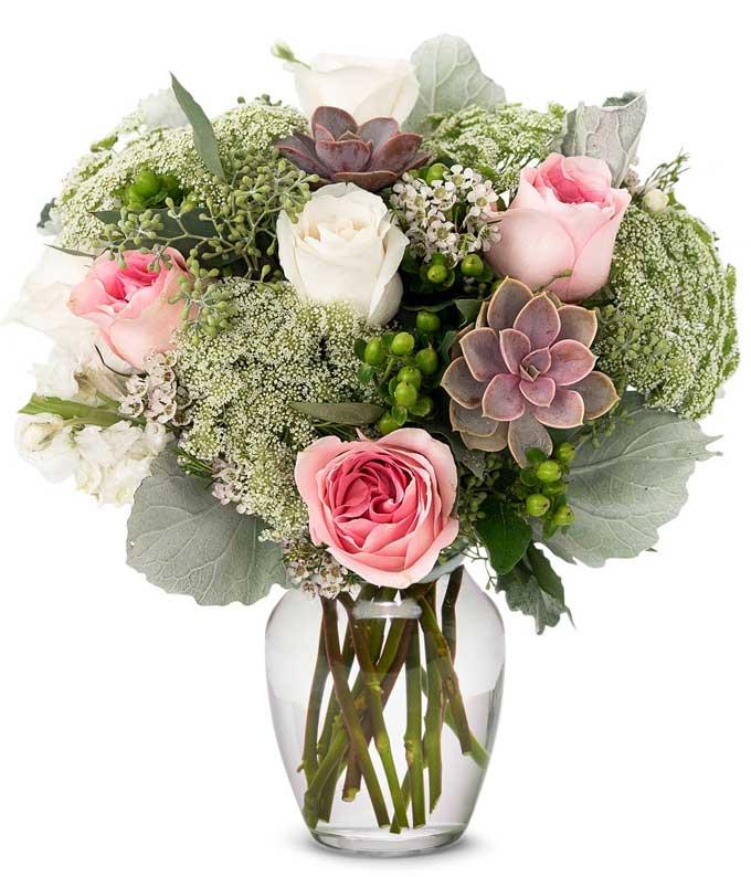 Pink rose and succulent arrangement