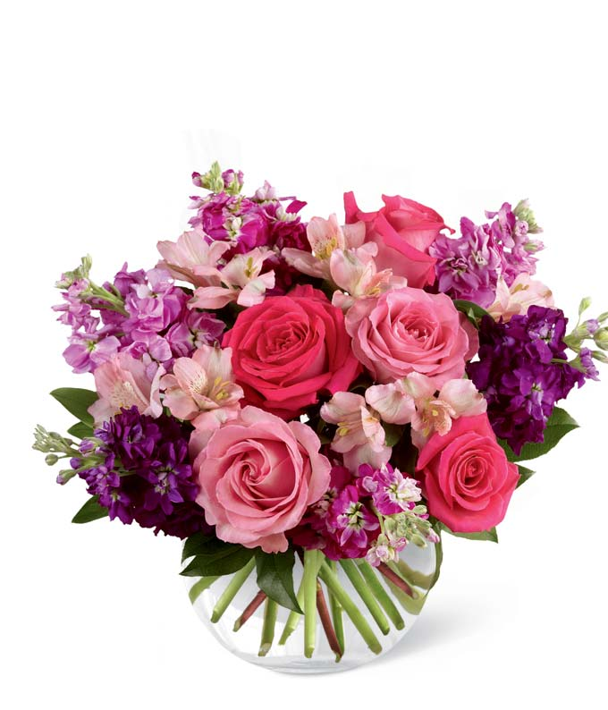 Purple flowers arranged with hot pink roses