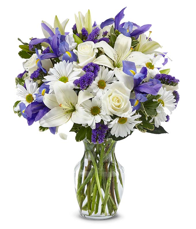 Sympathy bouquet with white roses and blue iris