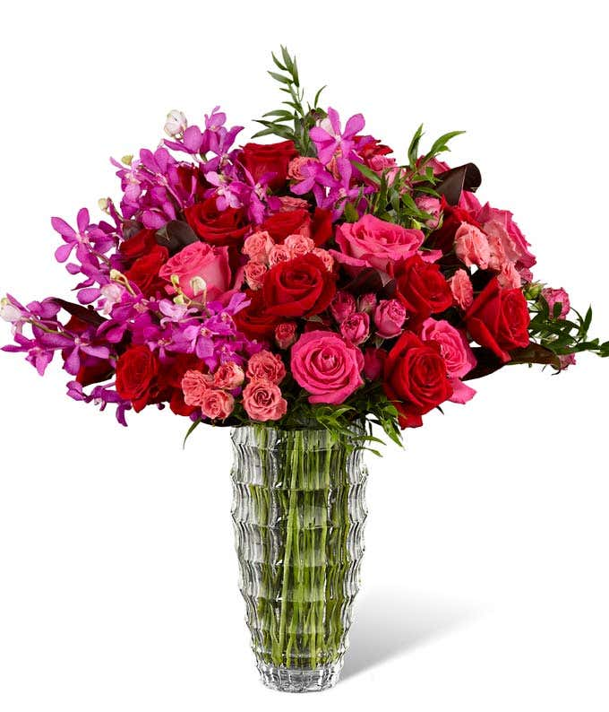 hot pink flowers arranged with red roses