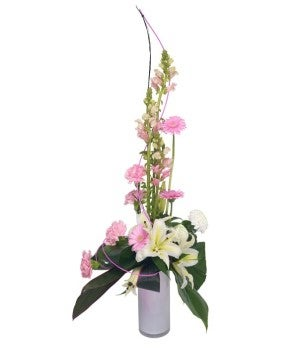 Pink and white flower arrangement with daisies for delivery internationally.