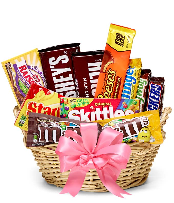 Candy delivered in a basket with a pink bow