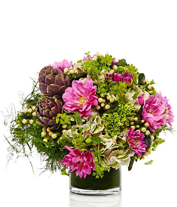 Fresh flowers in a cylinder vase