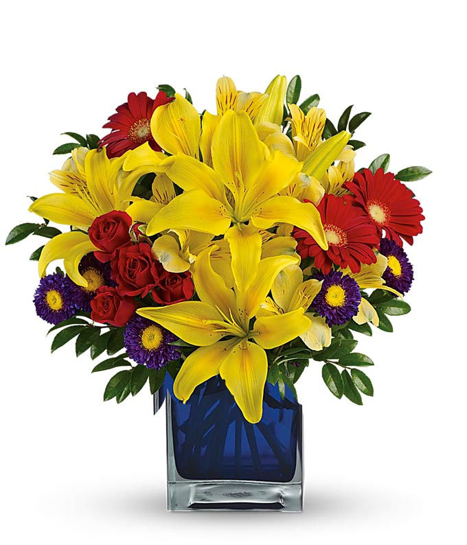 Yellow lilies, red flowers and purple asters bouquet
