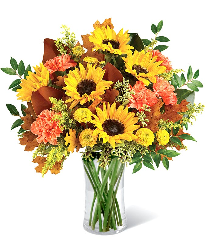 Mixed Fall bouquet with sunflowers, orange carnations and oak leaves