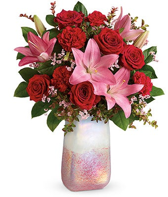 Red roses, red carnations and pink lilies in a modern valentine vase
