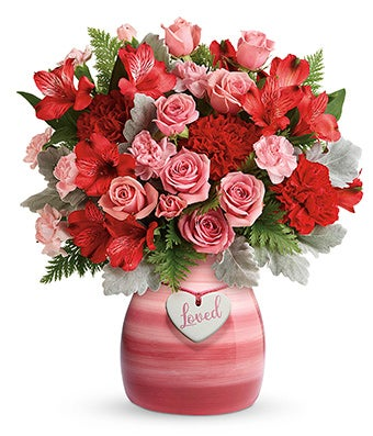 Mini roses and alstroemeria for valentines with 'loved' decoration