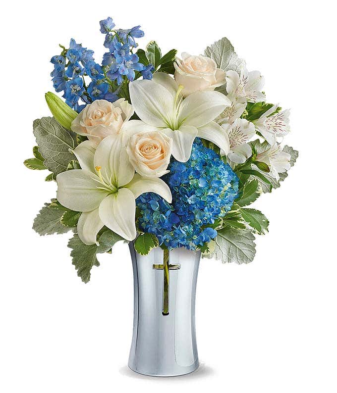 Cross vase with white roses and blue hydrangea