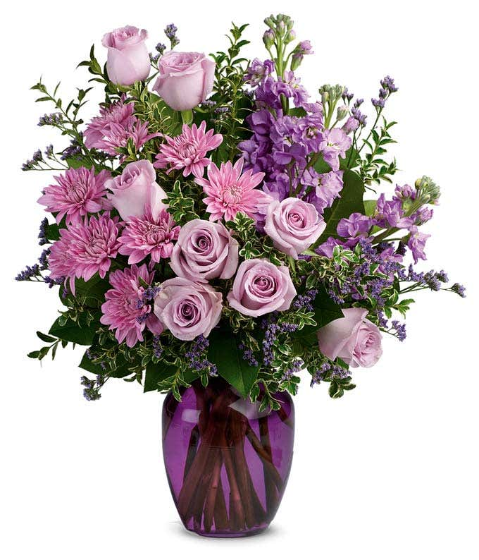 All purple arrangement with purple roses and purple mums
