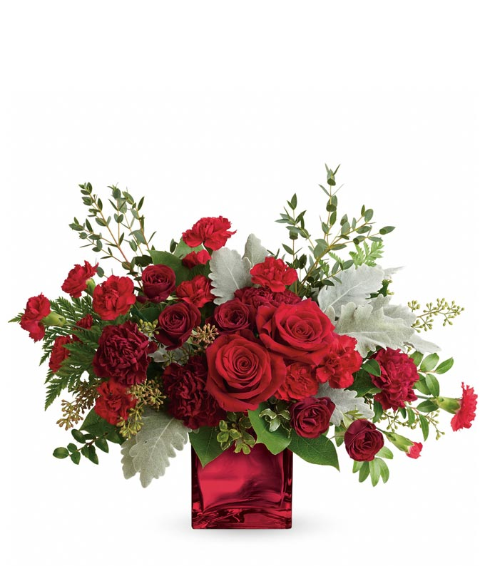 Luxury red rose and red carnations bouquet in a red cube vase