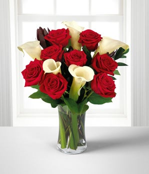Red roses delivered with white calla lilies