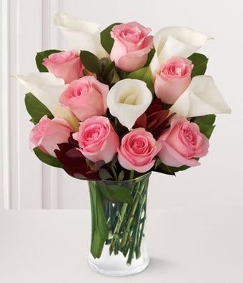 Pink roses delivered with white calla lilies