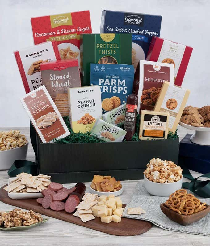 Gourmet snack basket with cheese, chocolate, sausage and more