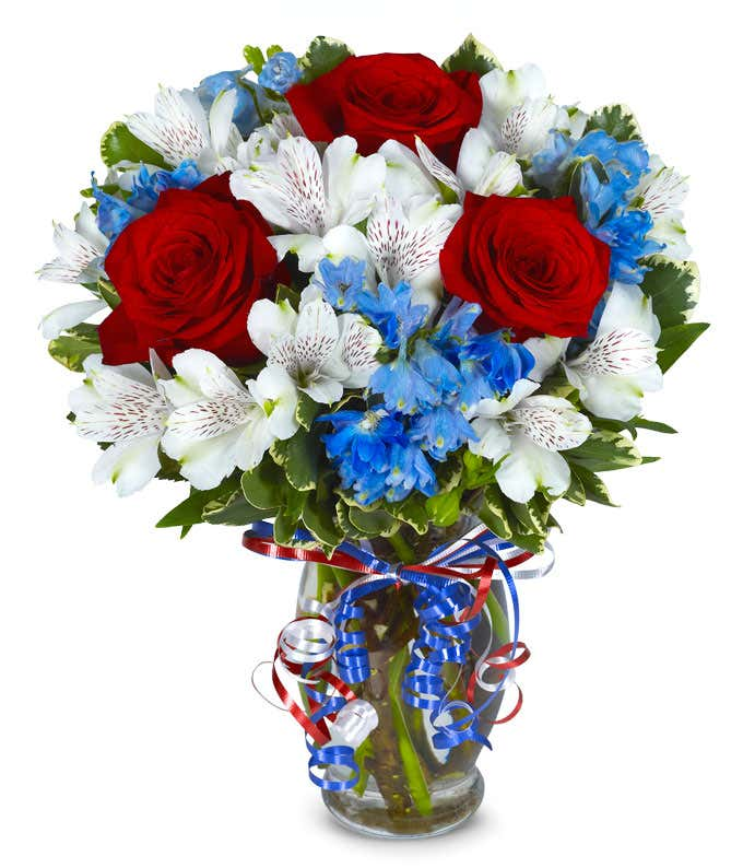 Red roses, white alstroemeria and blue flowers for a patriotic arrangement