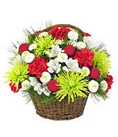 Red carnations, white alstroemeria and spider mums in basket