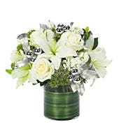 Circular white lilies and white rose bouquet