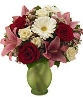 Red roses, pink lilies and gerbera daisies in green vase