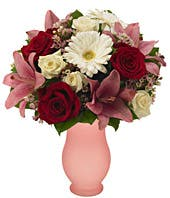White gerbera daisies, red roses and pink lilies in vase
