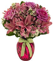 Pink roses, white monte casino and pink asltroemeria in pink vase