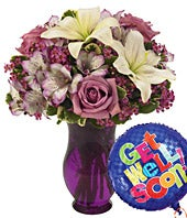 White lilies with purple roses with get well balloon