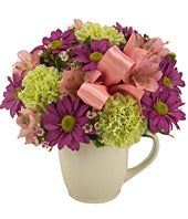 Pink alstroemeria, purple daisies and green poms in a mug