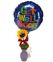 Sunflowers decorated with smiley face and get well balloon