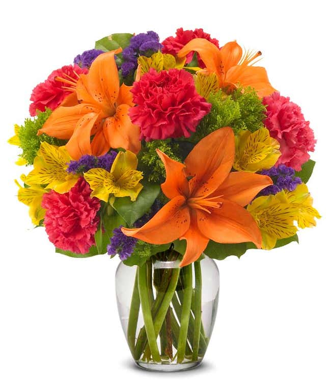 Orange lilies, Yellow alstroemeria, and hot pink carnations delivered by florist in orange vase