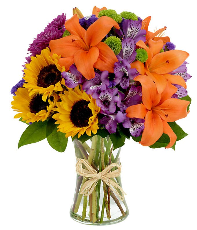 Mixed arrangement with sunflowers, orange lilies and purple flowers
