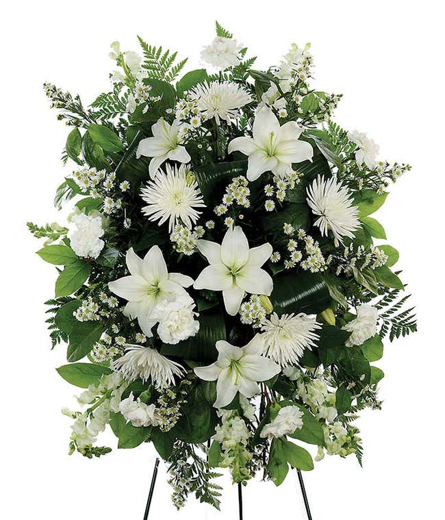 Funeral flowers with white lilies and white mums in standing spray
