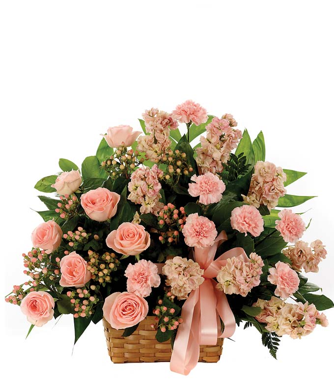 Sympathy floral basket with peach roses and hypericum