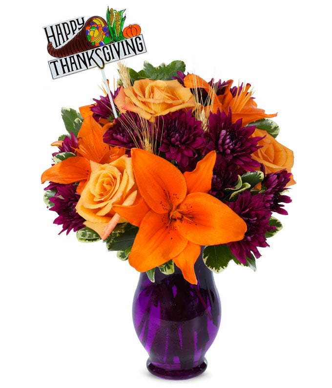 Orange roses & lilies delivery in a purple vase