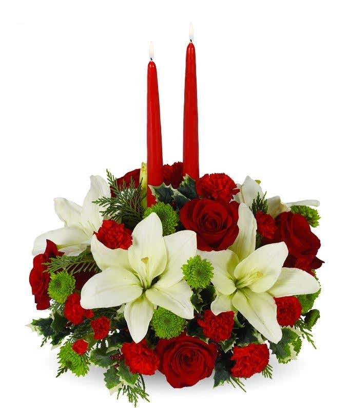 White lilies and red carnation holiday centerpiece with tapered candles