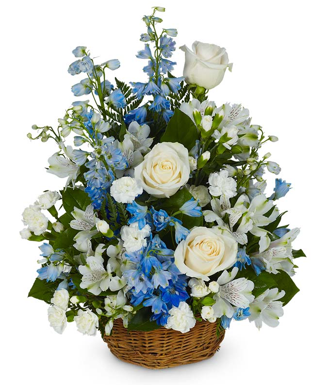 Sympathy floral basket with white roses, carnations and alstroemeria
