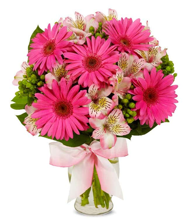 Pink gerbera daisies with pink alstroemeria and hypericum berries bouquet