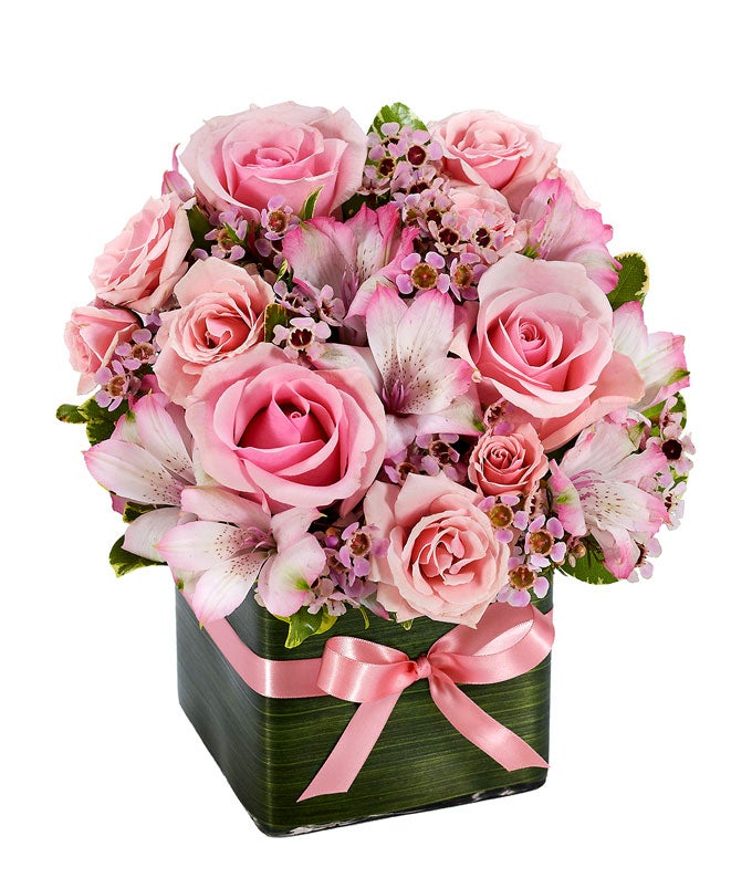 Pink roses, pink alstroemeria and pink wax flower