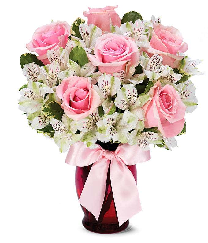 Pink roses and white alstroemeria in a pink vase