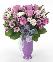 Purple roses, purple alstroemeria and ivory spray roses in purple vase