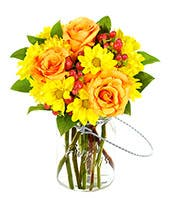 Orange roses, yellow daisies and red hypericum in a mason jar bouquet
