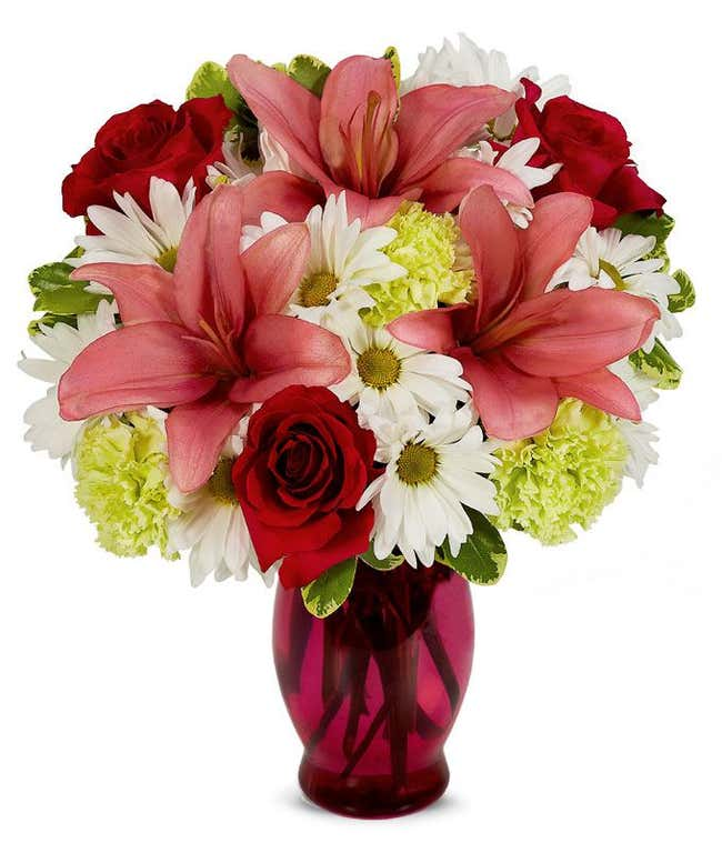 Pink lilies, red roses and white daisies bouquet