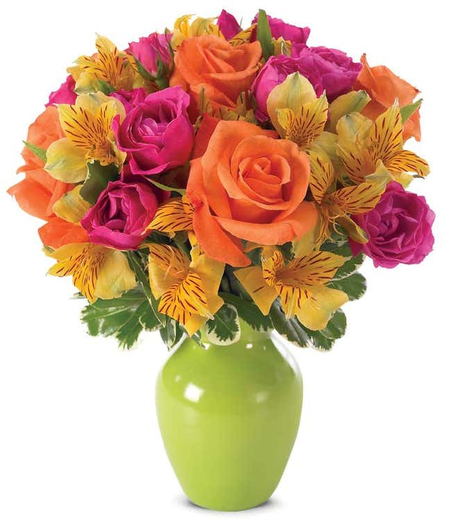 Orange roses, pink spray roses and yellow alstoermeria in a green vase