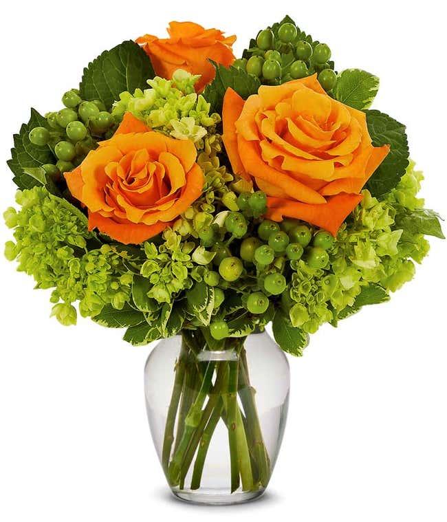 Orange roses and green hypericum berries