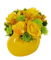 Yellow flower bouquet in duck vase