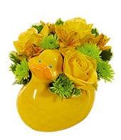 Yellow flower bouquet in duck vase