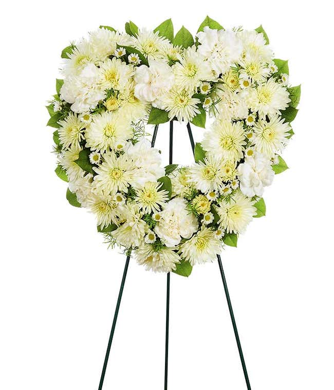 Heart shaped white flower funeral standing spray