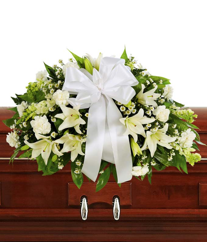 White Lily and White Carnations arranged as a casket spray