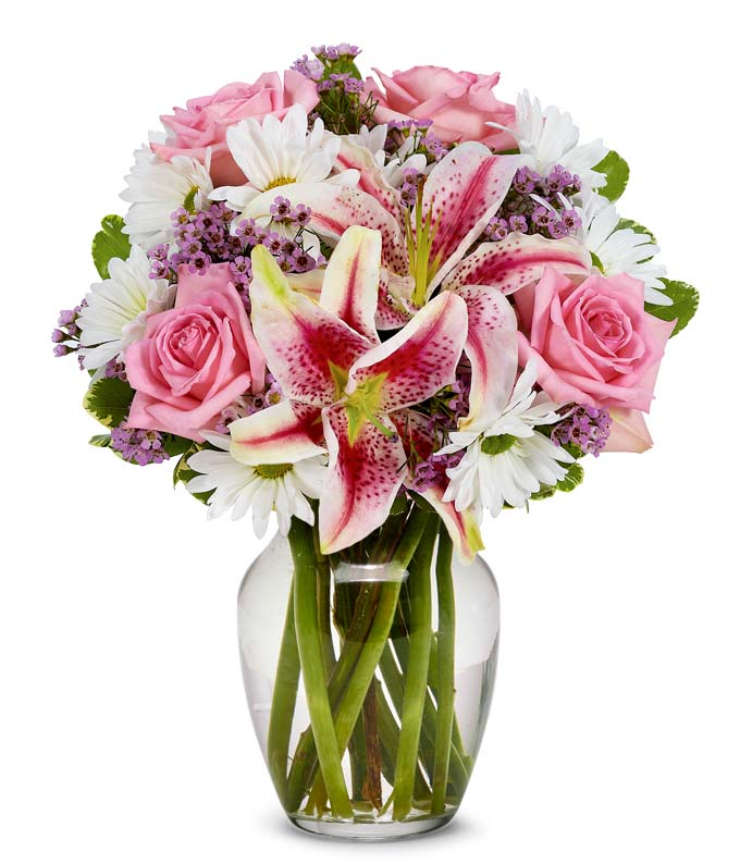 Pink roses, pink stargazer lilies and purple flowers