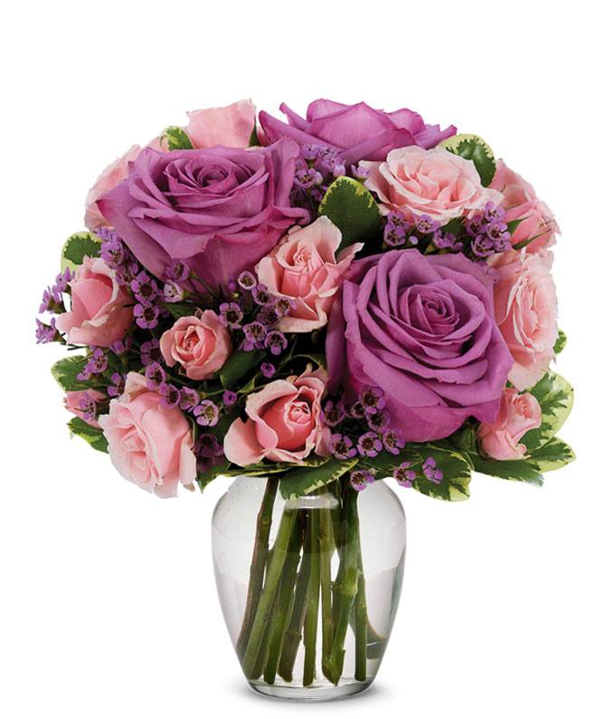 Purple roses paired with pink spray roses