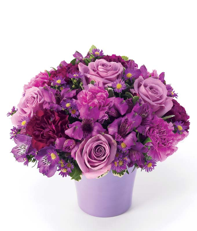Purple roses, purple alstroemeria and lavender carnations in vase