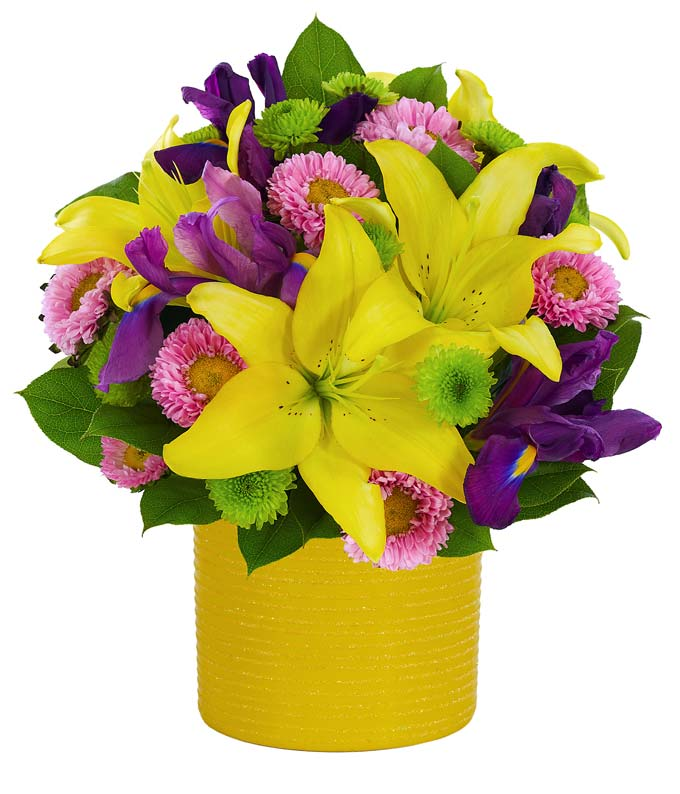 Yellow lilies, pink asters and irises in a yellow pot for delivery